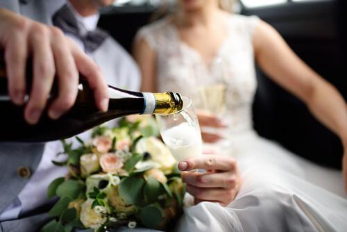 wedding couple enjoying champagne